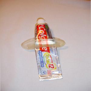 Wigon - Economizador de pasta de dente com gravação personalizada. Higiene e conforto para os seus clientes!