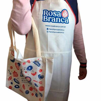 MPB Brindes - Kit contendo Avental em brim, amarração e alça em poliéster sem bolso Tamanho acabado 53x75 cm com impressão no peito e ecobag em tecido cru