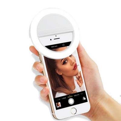 """Capital Brindes & Cia - Anel de iluminação para celular, utilizado para fotos em formato selfie. """"Ring light"""" plástico no formato """"presilha"""" para encaixe, possui três estágio..."""