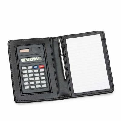 Brindes Qualy - Porta bloco de anotações com caneta e calculadora, capa de couro sintético, nas medidas: 14,8cm X 10,5cm