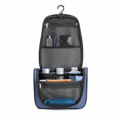 Blunn - Linda necessaire em nylon 600D de alta densidade. Com vários bolsos interiores e gancho de pendurar. Medidas: 250 x 180 x 105 mm. Disponível nas cores...