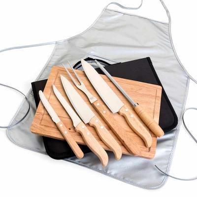 Brindez - Brindes Promocionais - Kit para Churrasco cabo em Bambu, laminas em aço Inox com avental. Acompanha tábua em Bambu, 3 facas de corte e uma de serra cabo de bambu/Inox, chair...