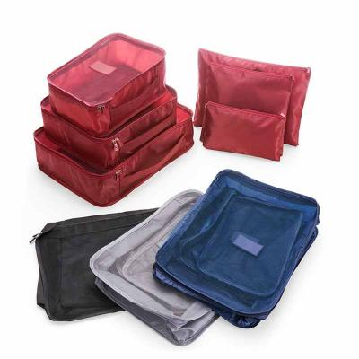 Fly Brindes - Kit necessaire com 6 peças confeccionadas em nylon. O cojunto de necessaires possui tamanhos diferenciados, sendo 3 unidades com: alça para transporte...