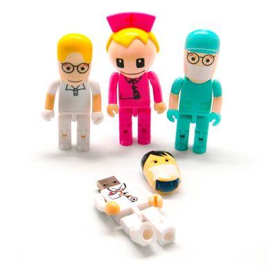 Direct Brindes Personalizados - Pen drive no formato de boneco médico e enfermeiro(a). Diversas opções de cor e modelo. Compatibilidade com Pc ou Notebook com entrada USB. Transferên...