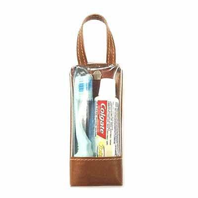 UP Couro - Estojo bucal, confeccionado em couro e sintético, contendo pasta e escova dental