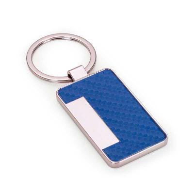 brindes-de-luxo - Chaveiro metal brilhante formato porta cartão, parte colorida em couro sintético texturizado e verso liso.Personalização a laser. Tamanho aproximado:...