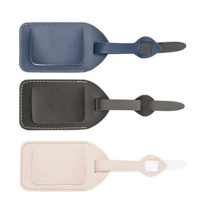 """MR Cooler - Identificador de bagagens Bidins em couro sintético. Possui """"fivela"""" ajustável, visor plástico e proteção de couro para a """"tela"""". Para colocar alguma..."""