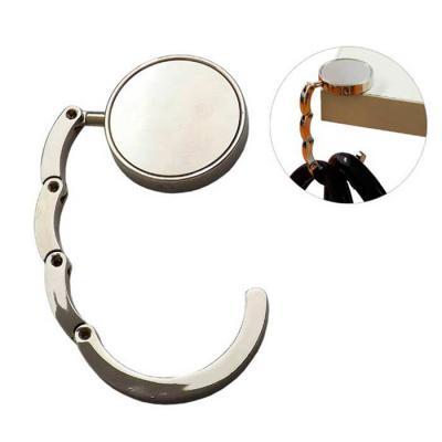 Galeria de Ideias - Porta bolsa redondo dobrável de metal. Gravação: etiqueta resinada.