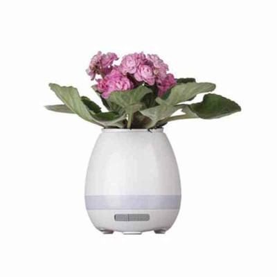 Shopping Brindes - Vaso de planta musical com bluetooth e sensor de toque. Material plástico resistente, possui haste de alumínio interna com sensor de toque, buraco int...