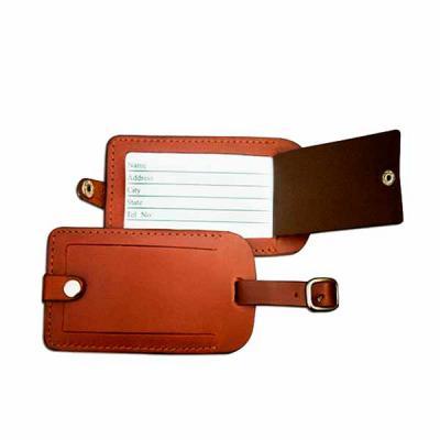 Thap  Brindes - Linda tag de Mala em couro sintético com gravação em baixo relevo. Material vip e de altíssima qualidade.
