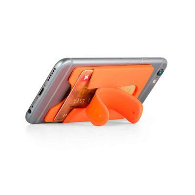 Mexerica Brindes - Porta cartões para smartphone, em silicone, com autocolante no verso e suporte para smartphone. Dimensões: 57 x 96 x 5 mm.