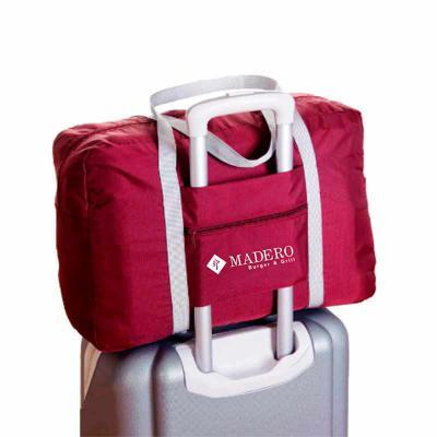 Canal Promocional - Bolsa viagem com encaixe para mala, disponível em diversas cores, produzida em nylon 210, possui dupla alça de ombro e bolso frontal. Medidas 48x32x16...