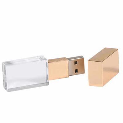 Box Brindes - Pen drive de vidro com tampa em metal dourado, personalizados com gravação laser.   Capacidades de 4, 8, 16, 32 GB.