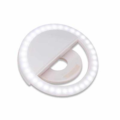 """Anel de iluminação para celular, utilizado para fotos em formato selfie. """"Ring light"""" plástico no formato """"presilha"""" para encaixe, possui três estágio..."""