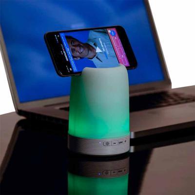 Libelula Express - Caixa de som multimídia com luzes, suporte para celular e porta caneta. Material plástico resistente na cor branca fosca, parte superior com falante v...
