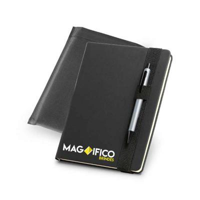 Magnifico Brindes - Bloco: caderno capa dura, com porta esferográfica e 140 folhas não pautadas cor marfim.  Esferográfica não inclusa. Fornecido em embalagem de non-wove...