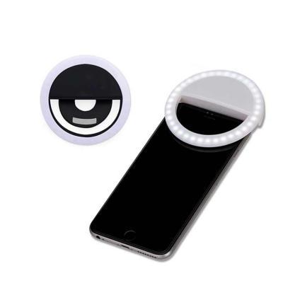 """Harmoniza Brindes - Anel de iluminação para celular, utilizado para fotos em formato selfie. """"Ring light"""" plástico no formato """"presilha"""" para encaixe, possui três estágio..."""
