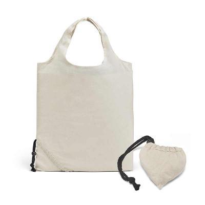 Envolve Promocional - Do lado direito, sacola de algodão dobrada. Do lado esquerdo, sacola aberta.
