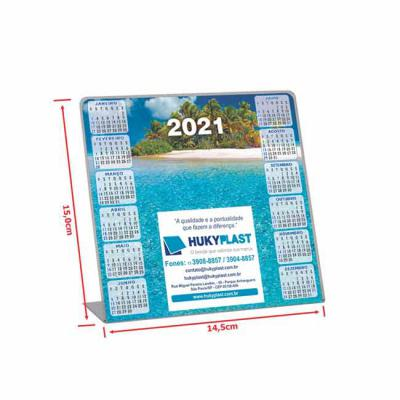 Hukyplast - Calendário de mesa impresso no papel em offset e encapsulado em plástico rígido transparente. Medidas:19x7,5x7,5 cm