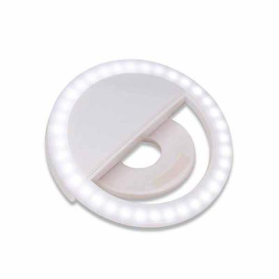"""Imagem Promocional - Anel de iluminação para celular, utilizado para fotos em formato selfie. """"Ring light"""" plástico no formato """"presilha"""" para encaixe, possui três estágio..."""